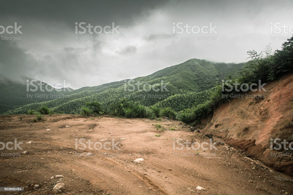 rock stone road in cloudy day with tire imprint for automobile commercial stock photo
