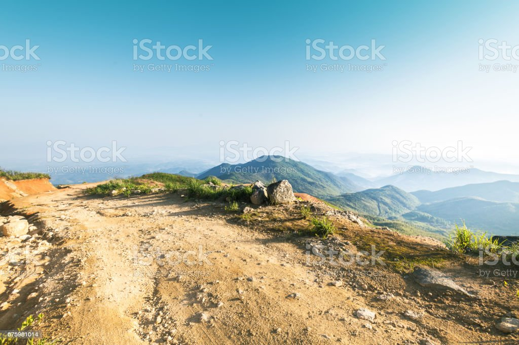 rock stone road in sunrise with tire imprint for automobile commercial stock photo