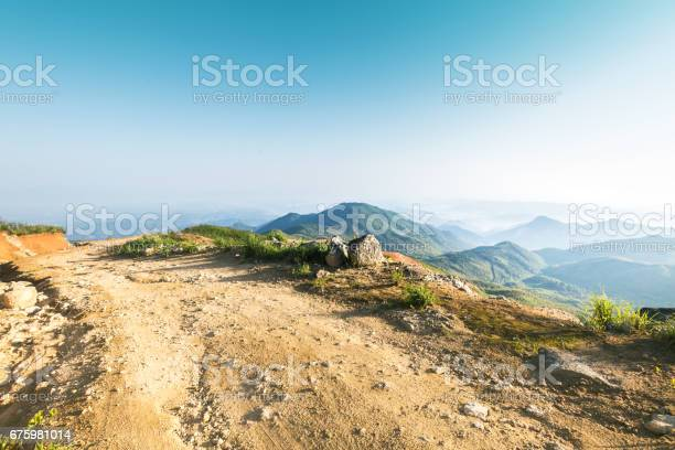 Photo of rock stone road in sunrise with tire imprint for automobile commercial