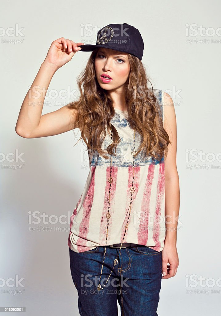 Rock style Woman, Studio Portrait Portrait of contemporary young woman wearing rock style clothes, looking at the camera. Studio shot, white background. 20-24 Years Stock Photo