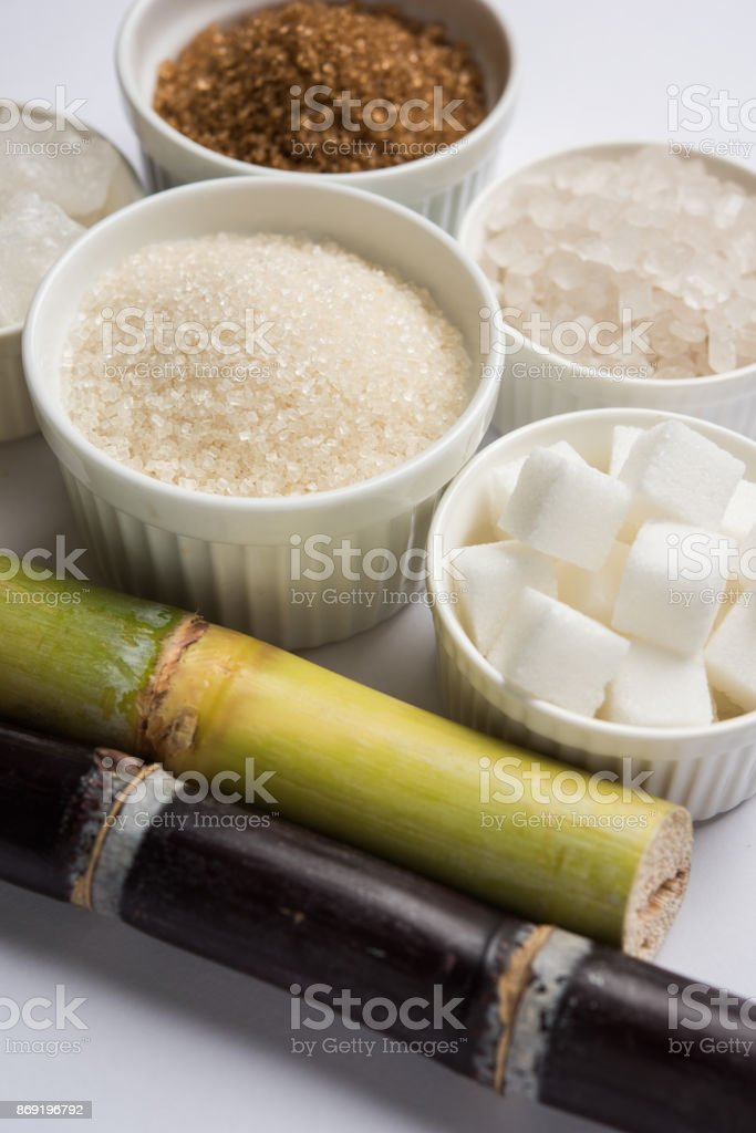 Rock Sugar crystal and cane - group photo of variety of Sugar which is a by-products of cane or ganna, selective focus stock photo