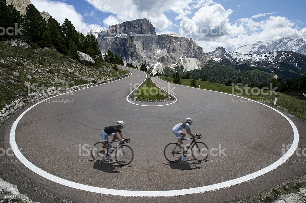 Rock the asphalt road cyclists stock photo