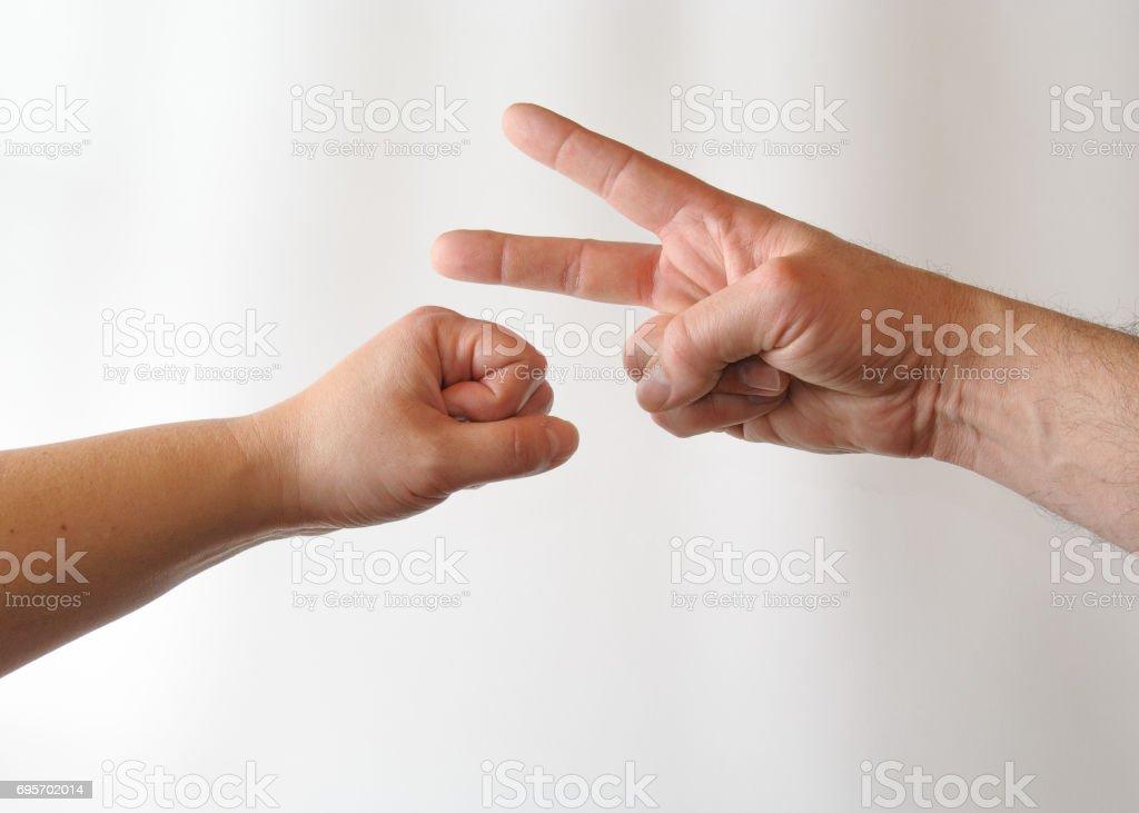 Rock versus Scissors stock photo
