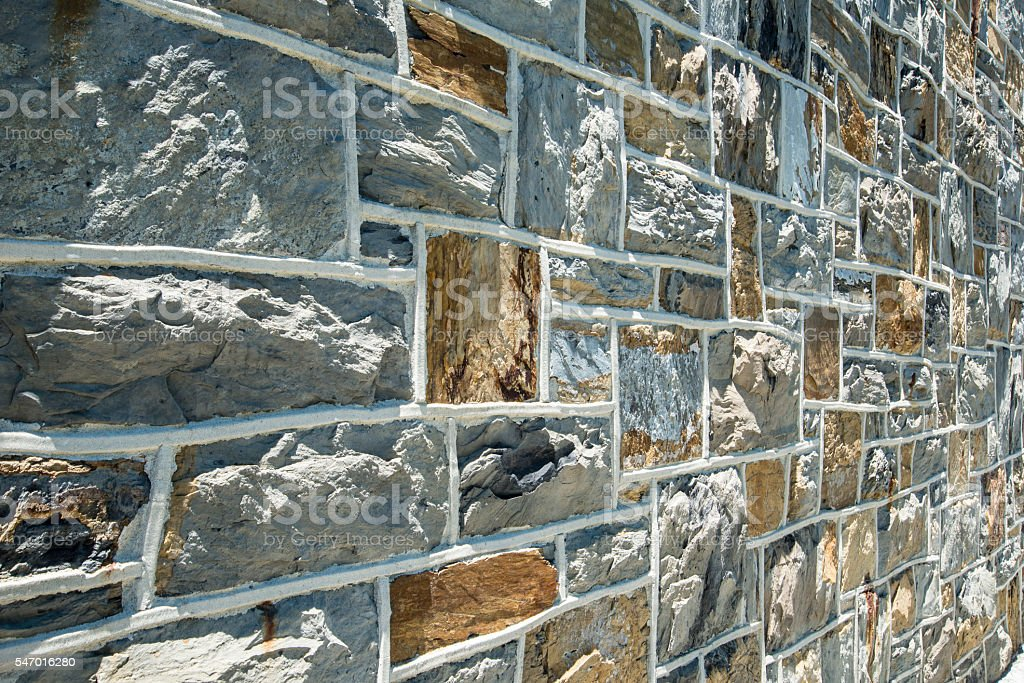 Rock wall of an old stone church. stock photo