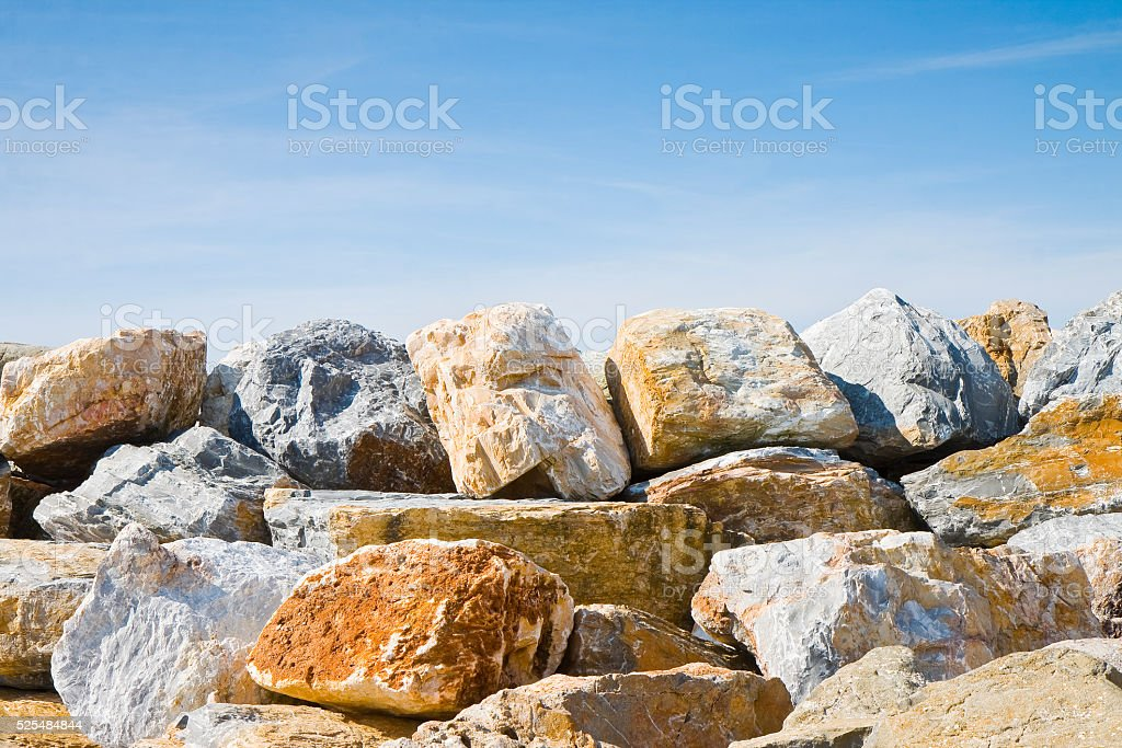 Rock wall protection from the waves - concept image stock photo