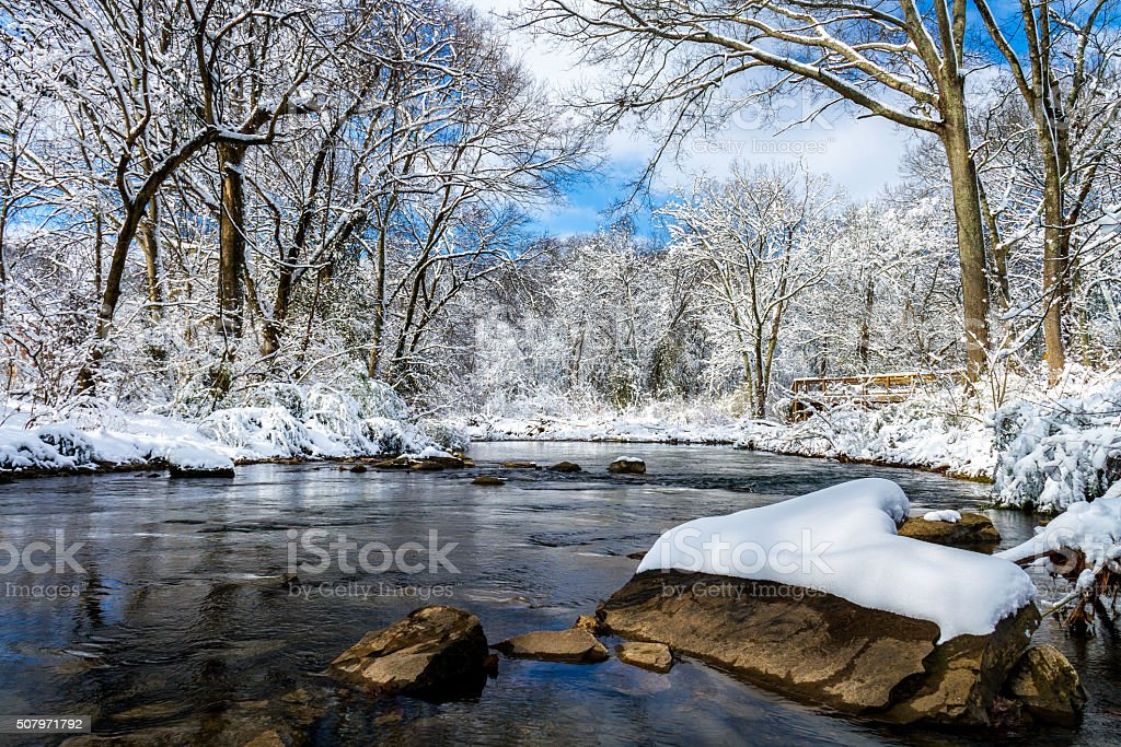 Rock with Snow in Richland Creek stock photo