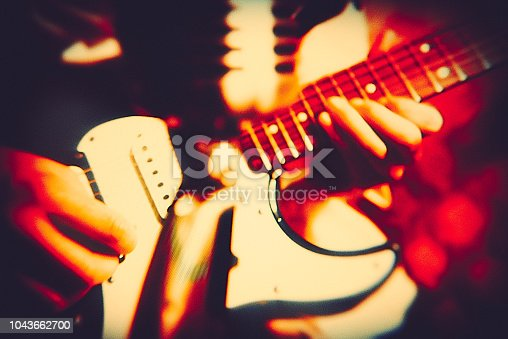 teenage boy playing the electric guitar