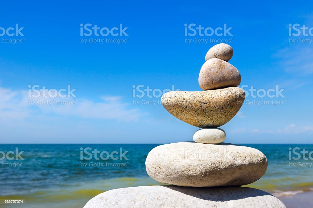 Rock Zen on the background of summer sea. Concept of stock photo