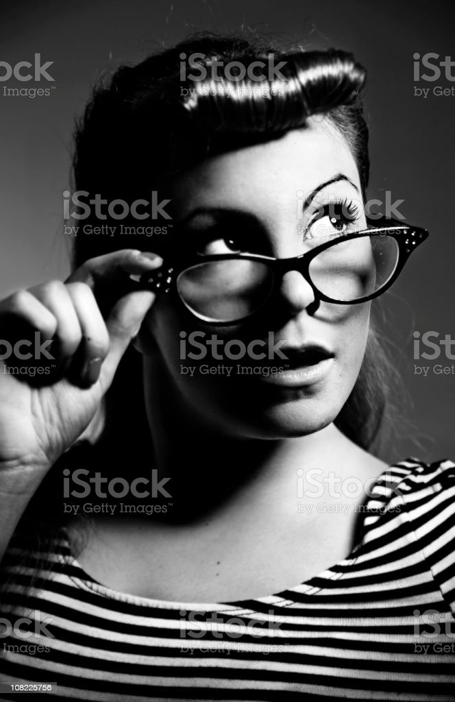Rockabilly Woman Posing with Cat Eye Glasses, Black and White royalty-free stock photo