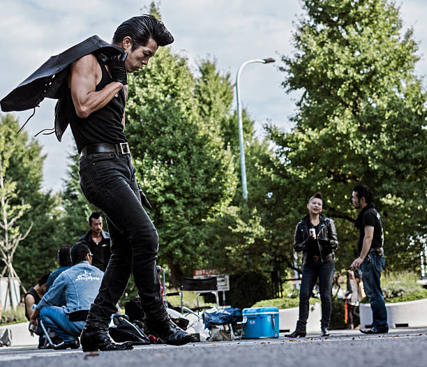 rockabilly's in yoyogi park tokyo japan - elvis stock photos and pictures