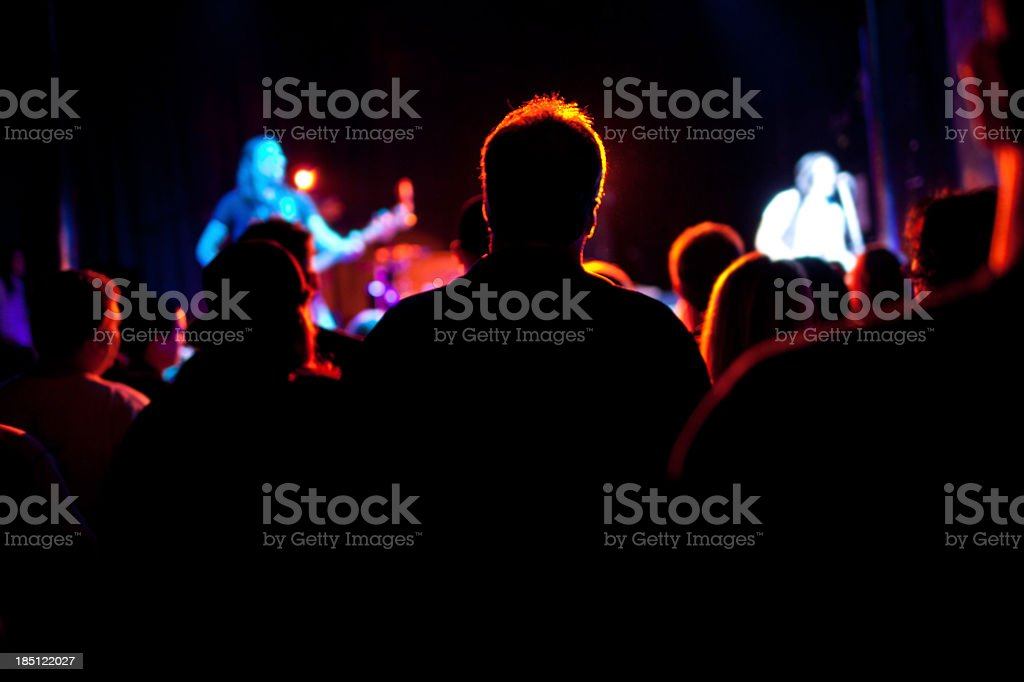 rockband fan in middle of concert stock photo