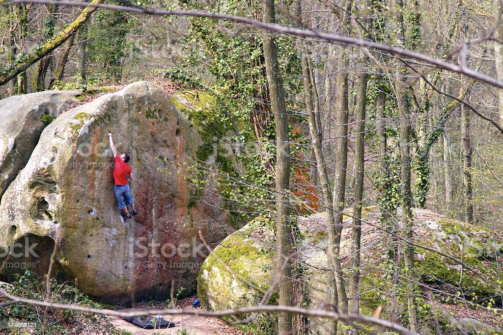 Rockclimber Bouldering in Fontainebleau stock photo