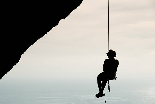 Rockclimber Overlooking Ocean stock photo