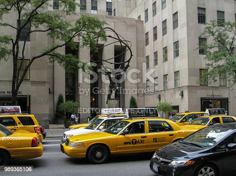 The Atlas statue and the yellow taxis in fifth avenue, rockefeller center, midtown Manhattan New York City.