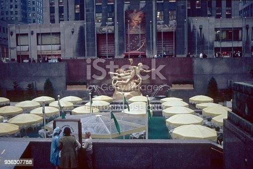 New York City, NYS, USA, 1968. The Rockefeller Center with the former shopping mall and the yellow parasols in the courtyard.