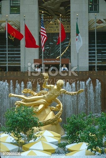 New York City, NYS, USA, 1982. The Rockefeller Center with the golden Prometheus stature in front of the entrance area.