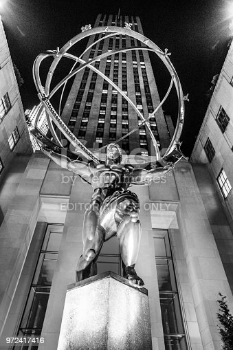 New York City, New York, USA - July 1, 2014:   Rockefeller Centre, a collection of several buildings, that make up the site, sits on some of the most prime real estate in New York City.  With construction commencing in the 1930's and spearheaded by investor, J.D. Rockefeller, the site has attracted many high end tenants.  This photo depicts the statue of Atlas, at the base of one of the on-site towers.