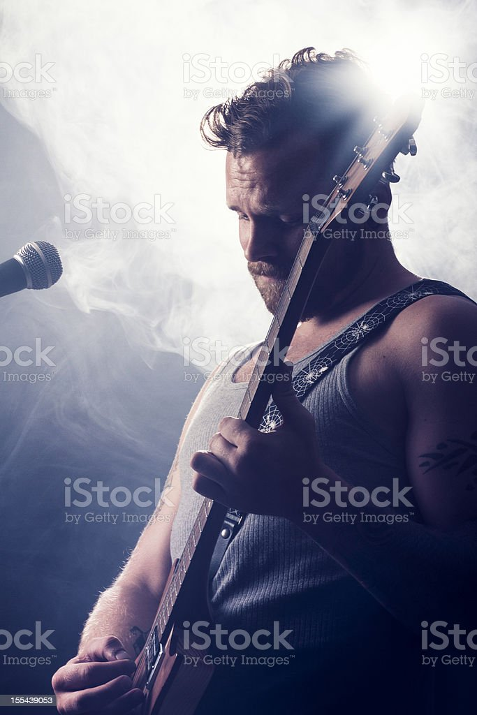 Rocker in Concert Play Guitar royalty-free stock photo