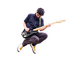 Rocker jumping with guitar, white background