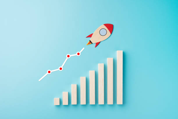 Rocket and chart on blue background business financial start up growth success concept object design stock photo