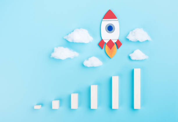 Rocket and chart on cloud blue sky background business financial start up growth success concept object design stock photo