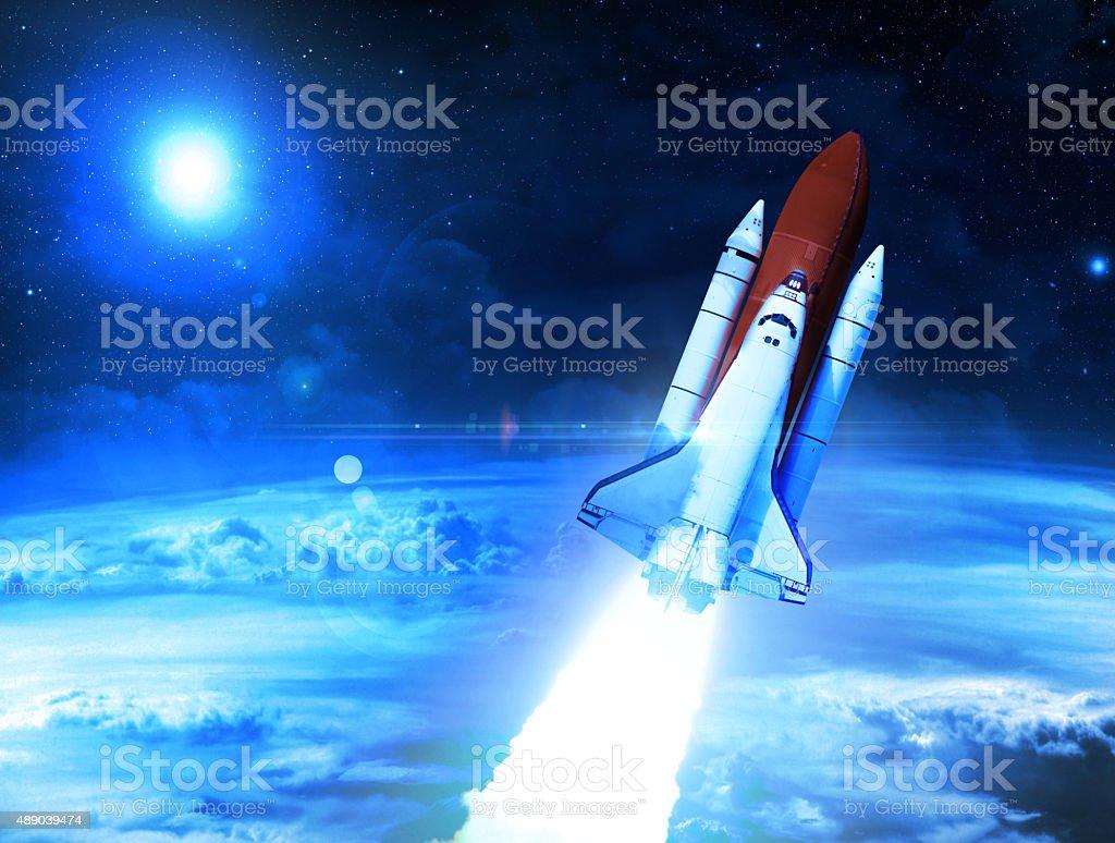 Rocket Blasting Through Space stock photo