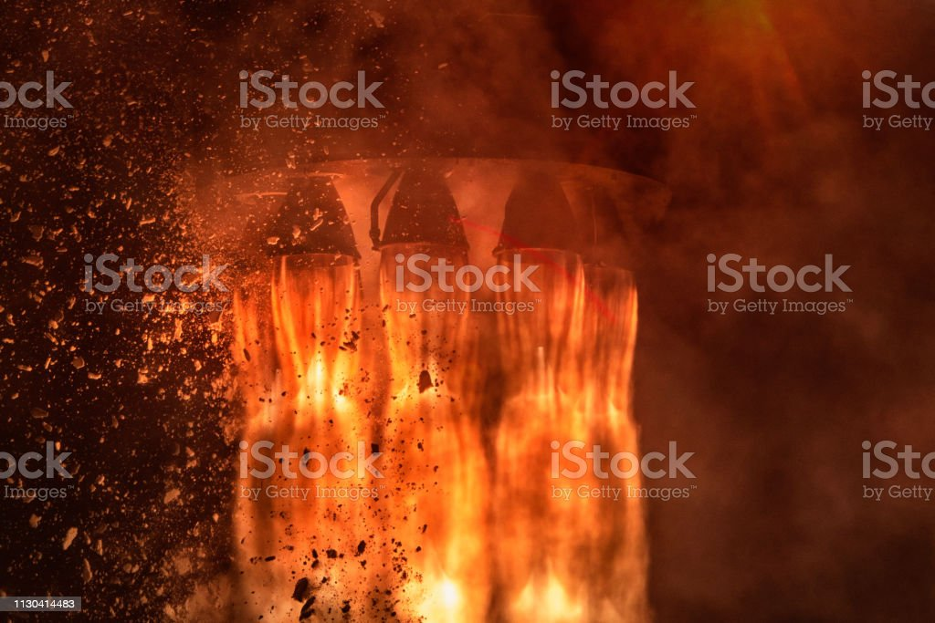 Rocket engines and fire duting the missile launch at night, close up...