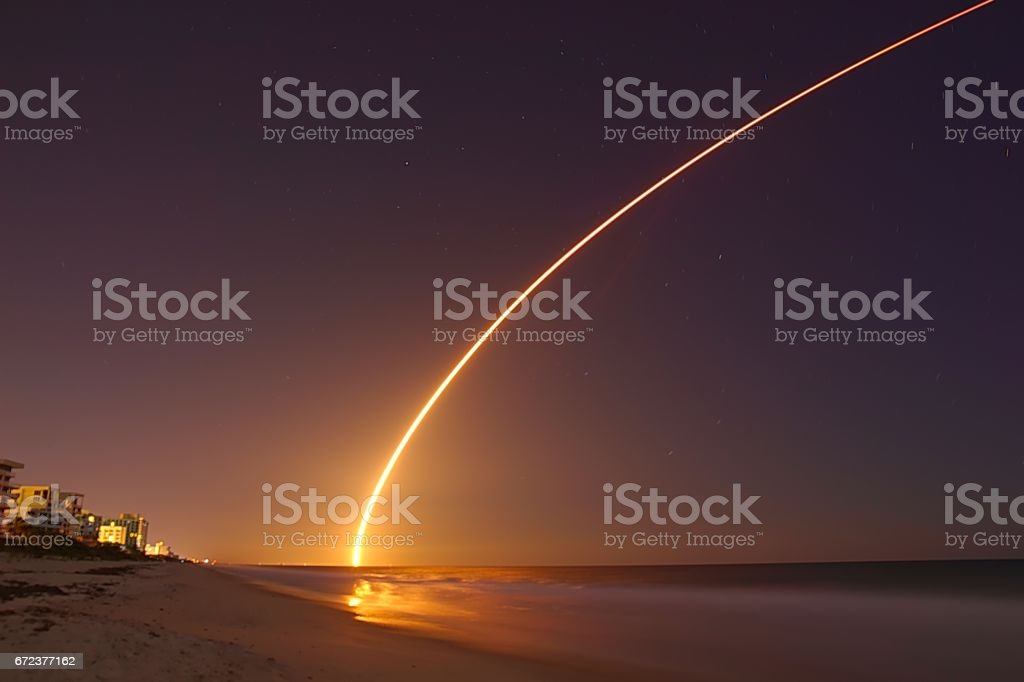 Rocket launch at night. stock photo