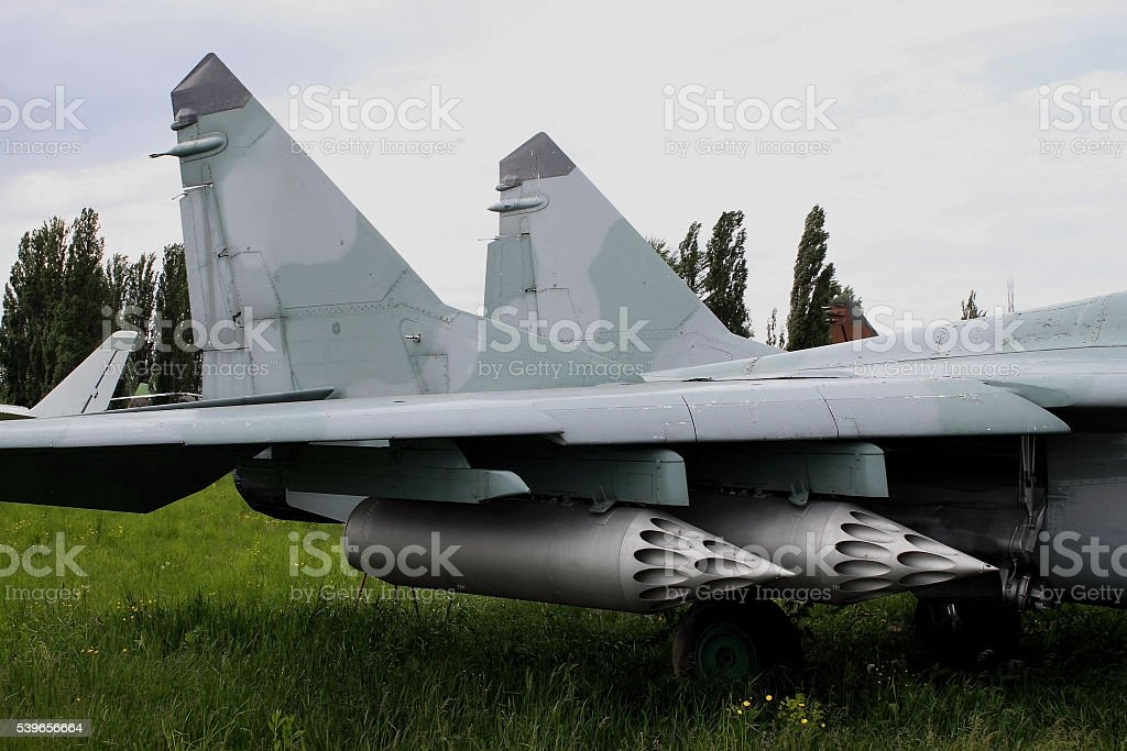 Rocket launcher system on the wing of military plane stock photo