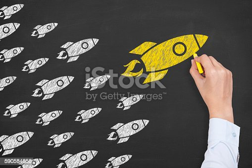 istock Rocket Leadership Concept on Chalkboard 590584858