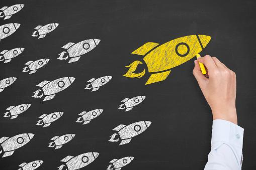 istock Rocket Leadership Concept on Chalkboard 590584858