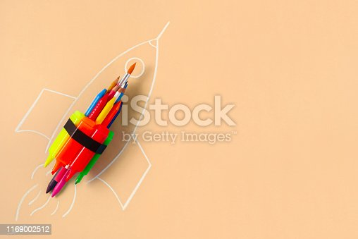 Rocket ship made by crayons and felt tip pen on yellow background