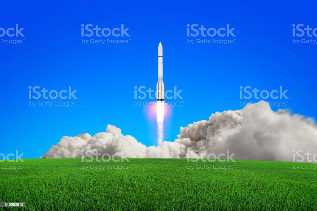 Rocket takes off into the sky. stock photo