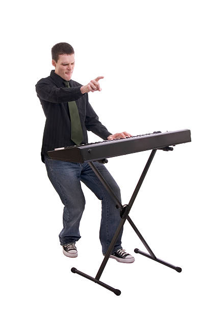 Rockin' Male keyboard player on white background. keyboard player stock pictures, royalty-free photos & images