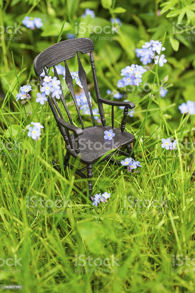 Rocking Chair in the Grass Vertical royalty-free stock photo