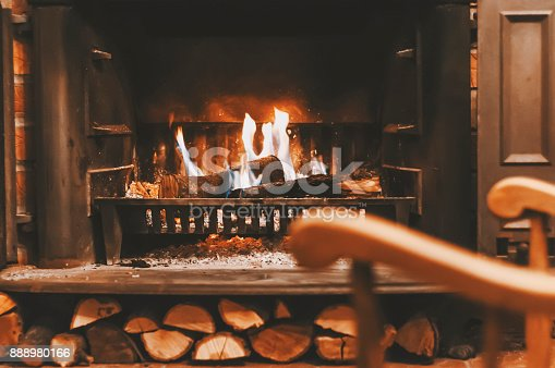 istock Rocking chair near the fireplace 888980166