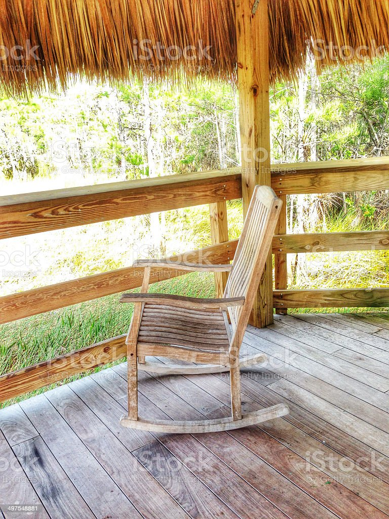 Rocking chair on deck royalty-free stock photo