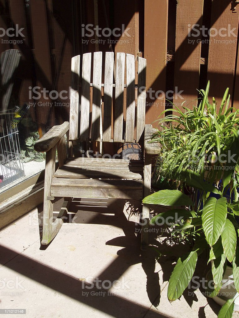 Rocking Chair on Sunny Deck royalty-free stock photo