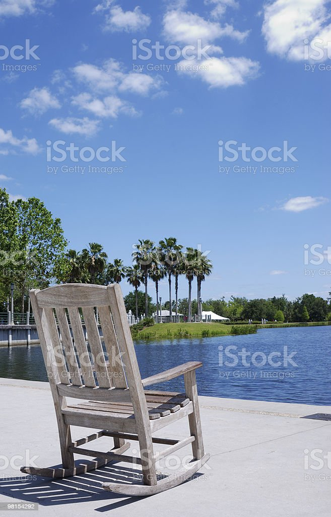 Rocking Chair on the Lake - Rest and Relaxation royalty-free stock photo