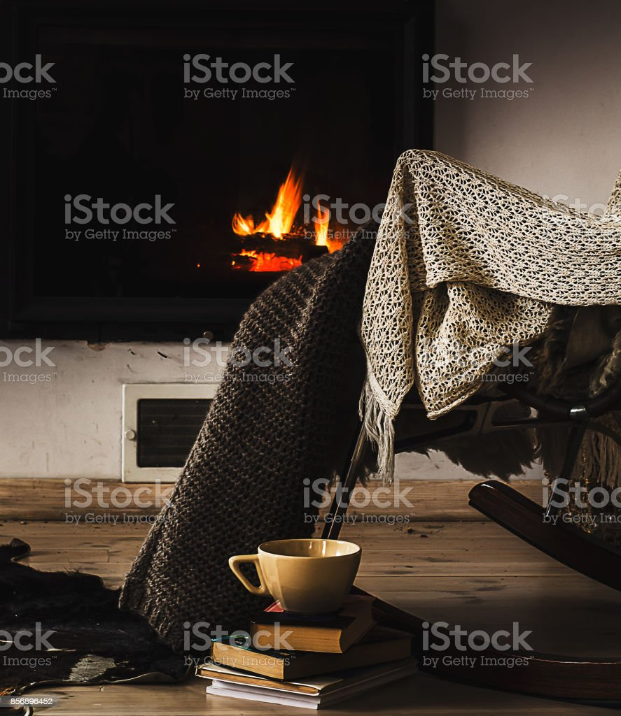 Sensational Rocking Chair With Knit Rug Books And Cup Of Tea Or Coffee Ibusinesslaw Wood Chair Design Ideas Ibusinesslaworg