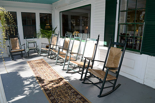 rocking chairs on an outdoor porch - carpet runner stock photos and pictures