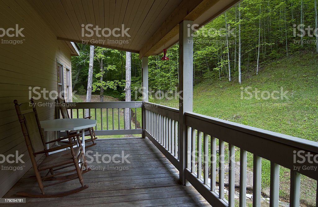 Rocking Chairs on Deck Overlooking Woods stock photo