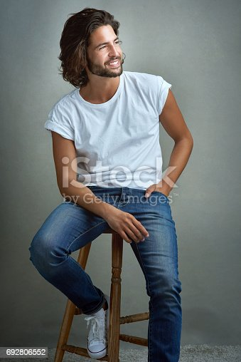 Studio shot of a handsome young man posing against a grey background