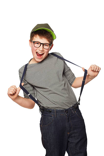 Rocking his suspenders A teenage boy wearing a hat and glasses while pulling his suspenders suspenders stock pictures, royalty-free photos & images