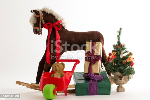 istock rocking horse and gift 513204285