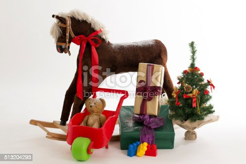 istock rocking horse and gift 513204293