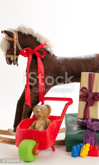 istock rocking horse and gift 513204305