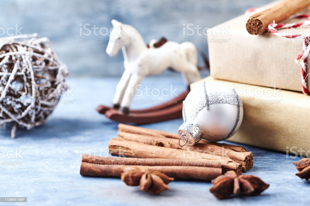 Rocking Horse Christmas Star Bauble And Christmas Presents Wooden Background Stock Photo Download Image Now Istock