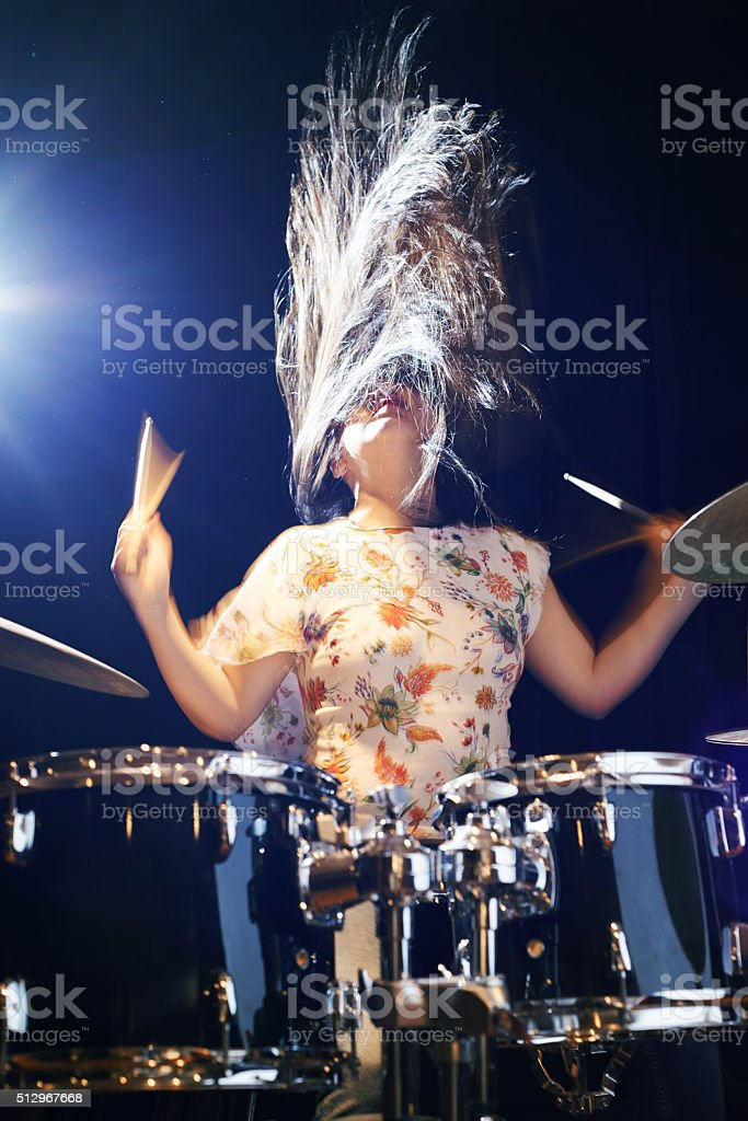 Rocking out on the drums stock photo