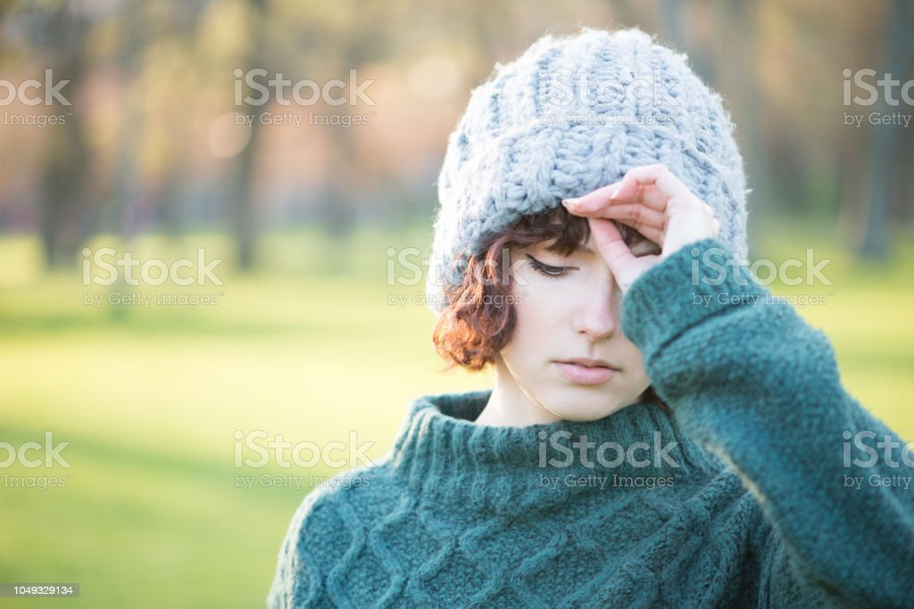 Rocking the Wool Knit Hat and Sweater Look stock photo